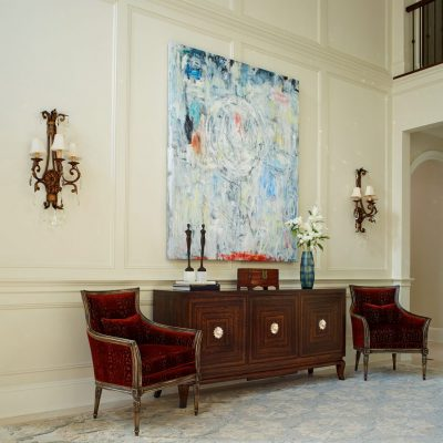 photo of entryway with antiques and contemporary art