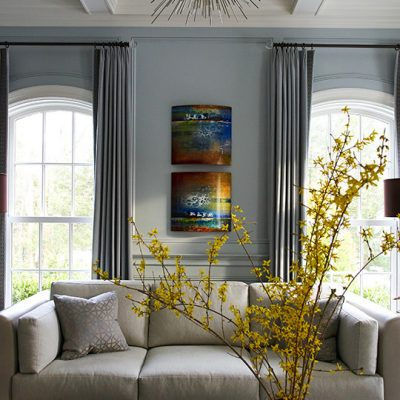 photo of forsythia flowers on living room table