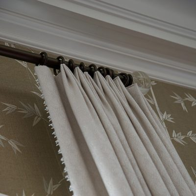 detail photo of neutral fabric window treatment