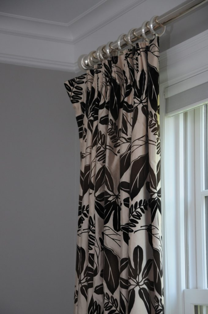detail photo of natural print fabric window treatment