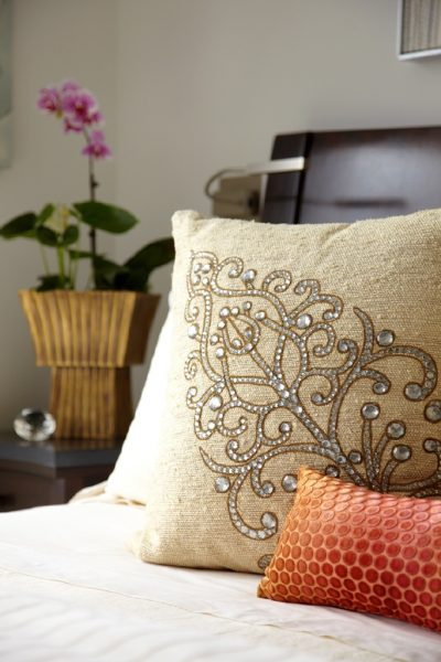 detail photo of custom designed pillows with beading
