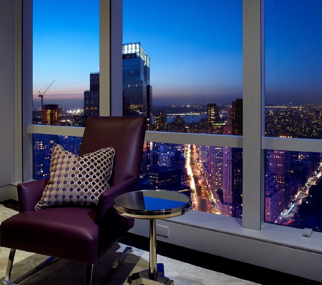 photo of view from new york city apartment with modern recliner