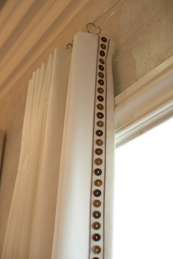 detail photo of custom window treatment with button edging