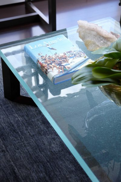 detail photo of contemporary glass top coffee table