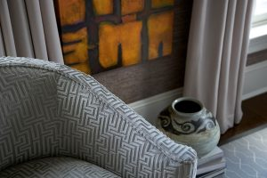 close up of gray geometric pattern upholstered chair