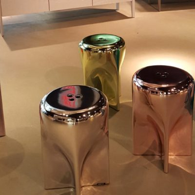photo of chrome side tables by Roche Bobois